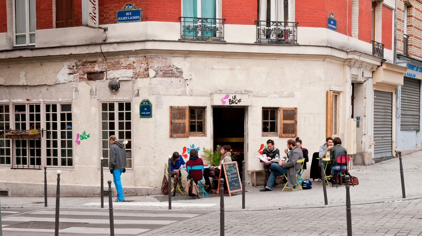 Stop by a café-restaurant in Belleville, Paris for delicious food and top people-watching