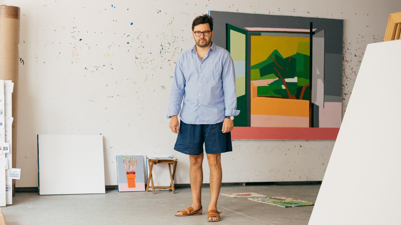 Israeli artist Guy Yanai poses for a portrait at his studio in Tel Aviv