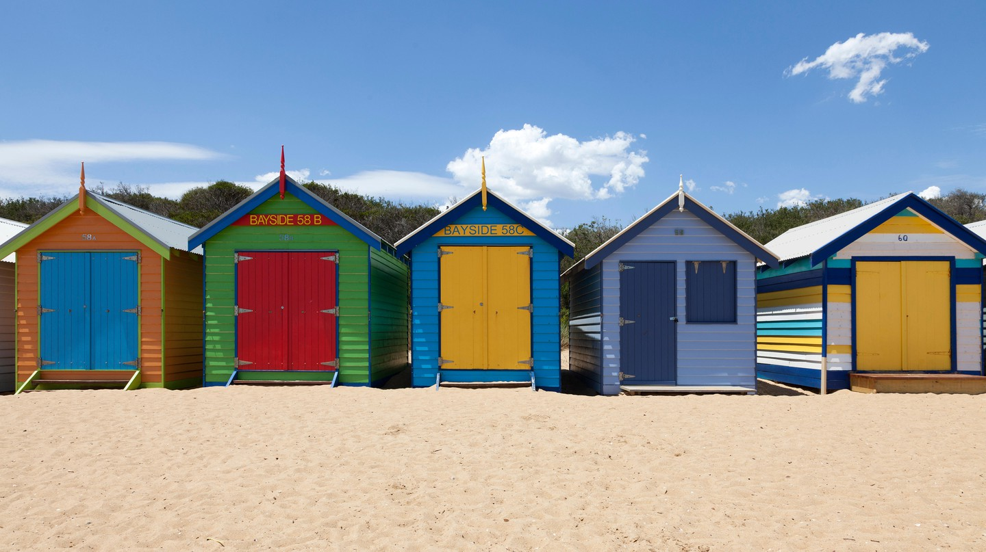 Painted beach huts adorn Brighton Beach