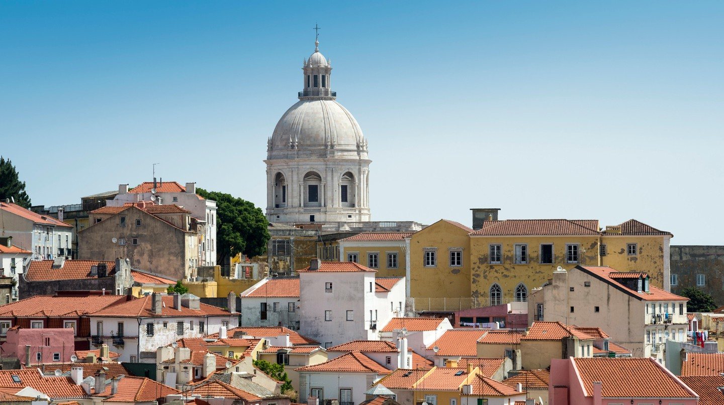 Lisbon's Alfama neighbourhood is a maze of cobblestone alleys with amazing city views