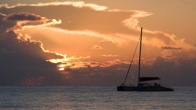 Watch the sun set on a relaxing catamaran cruise off Seven Mile Beach