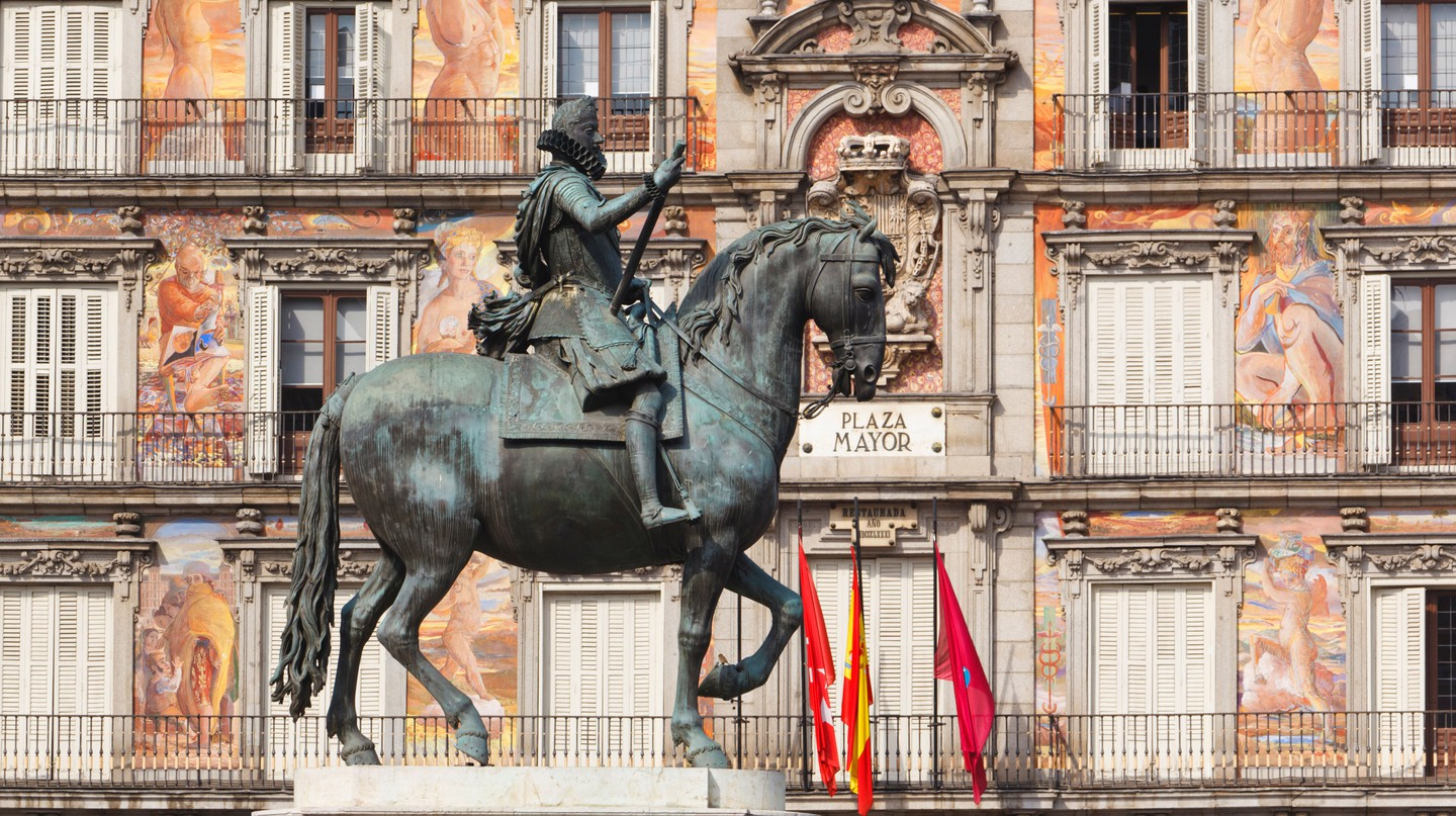 A statue of King Felipe III stands in Madrid's Plaza Mayor