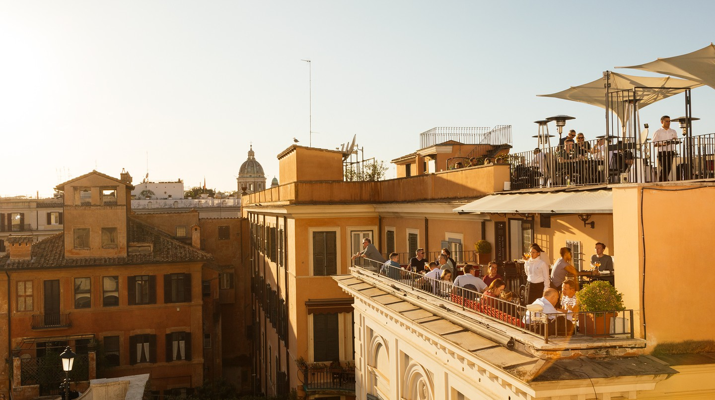 An unbelievable vantage greets revellers at a bar adjacent to Rome's Spanish Steps
