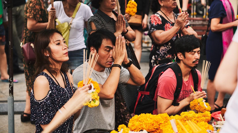 People pray at Bangkok's shrines for many reasons