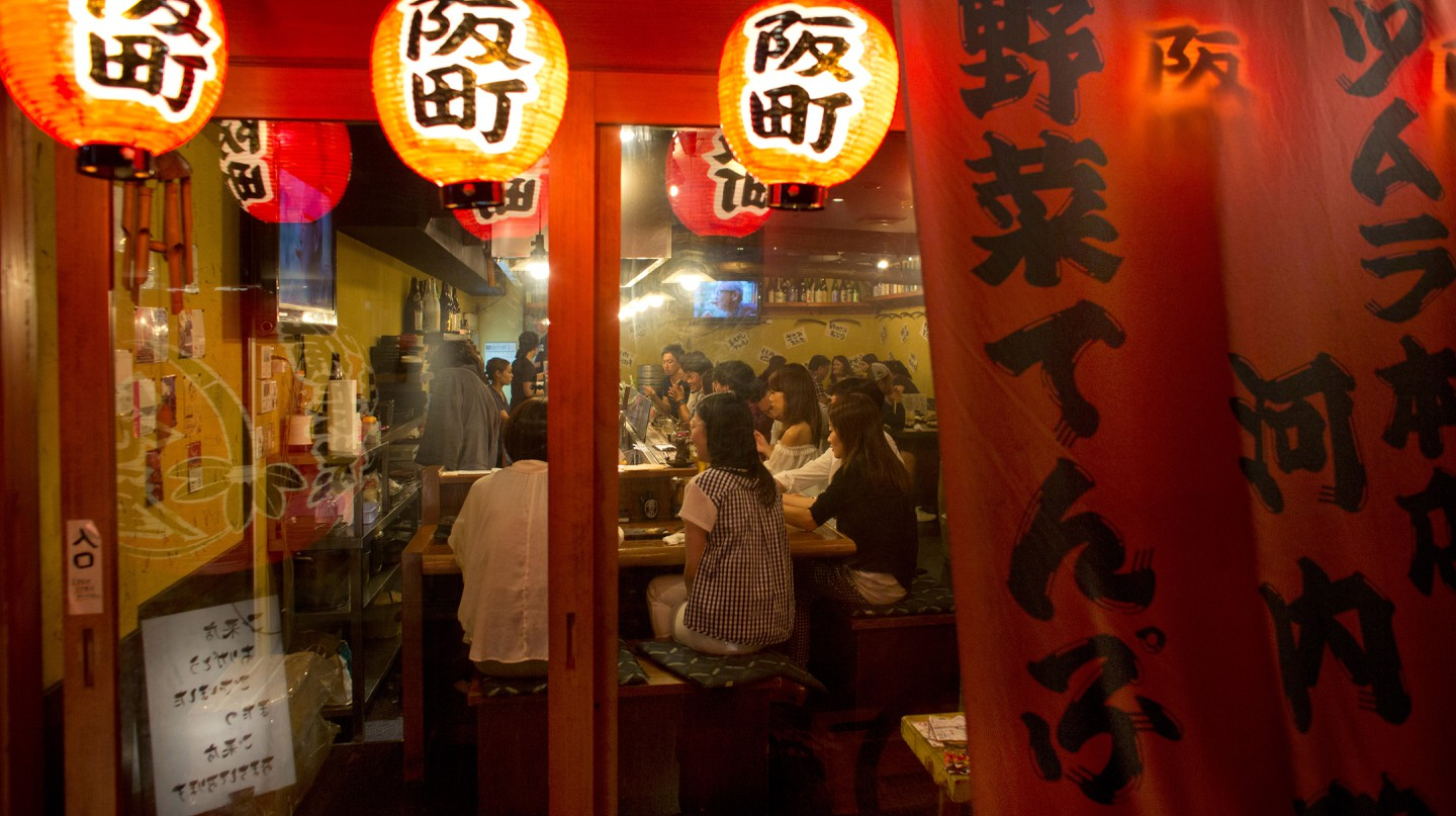 An izakaya typically serves both drinks and small plates of food