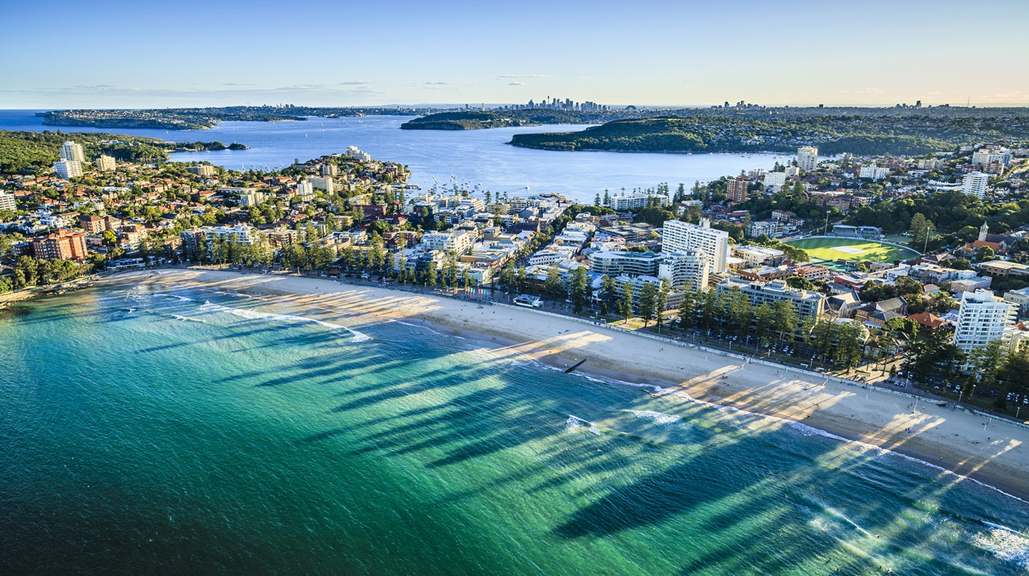 Immerse yourself in the sun, sea and surf of Sydney at Manly Beach