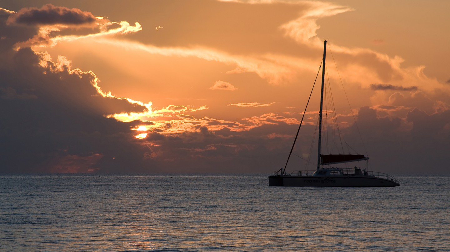 Watch the sun set on a relaxing catamaran cruise off Seven Mile Beach |