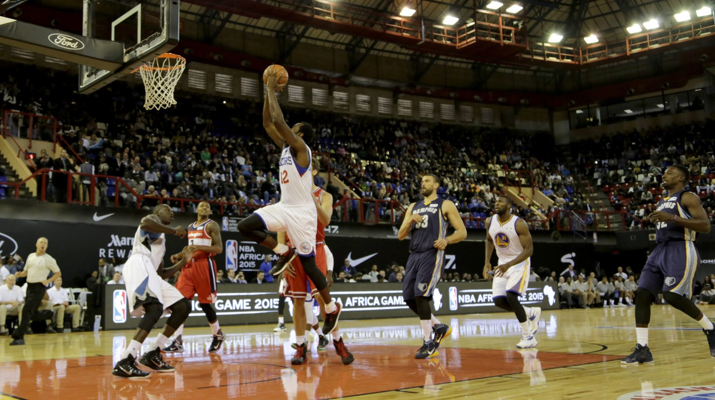 Luc Mbah a Moute slam dunks during a basketball match