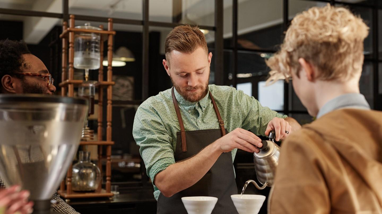 Barista pouring fresh coffee