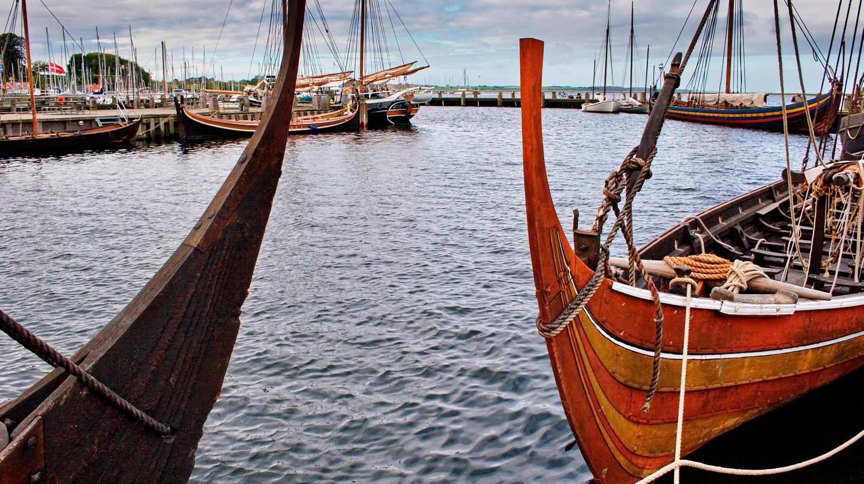 Replicas of Viking longships moored at Viking Ship Museum in Roskilde