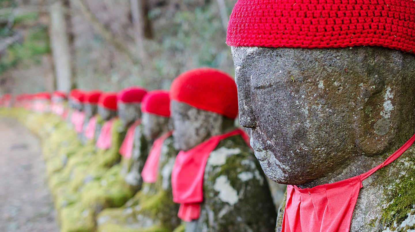These statues are known as the Ghost Jizo because if you count them on the way up and again on the way back down, there will be a different number