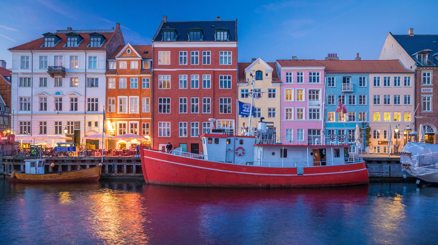 Nyhavn's 17th-century waterfront is colorful at dusk
