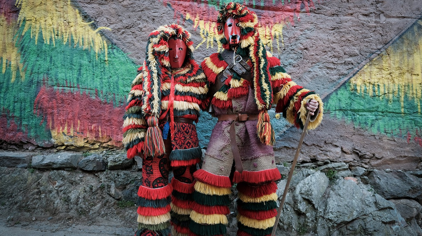 Revellers – known as 'caretos' – dress up in costumes of colourful wool fringes and leather masks to impersonate the devil during the Caretos Festival