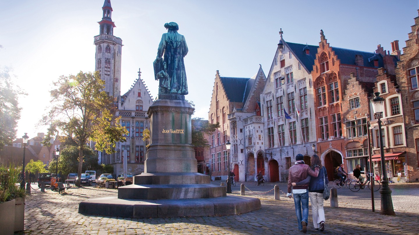 A statue of Jan van Eyck stands proudly in Bruges