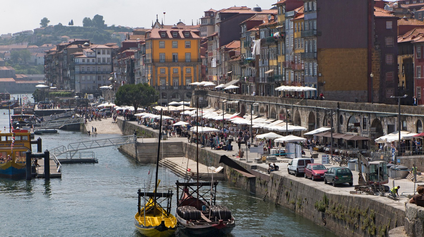 The Douro River flows past Ribeira in Porto, Portugal