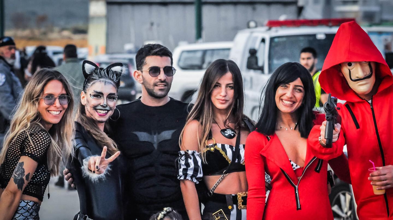 Revellers wear fancy dress for the Purim party in Tel Aviv, Israel