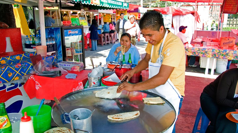 A food vendor makes quesadillas in Mexico City