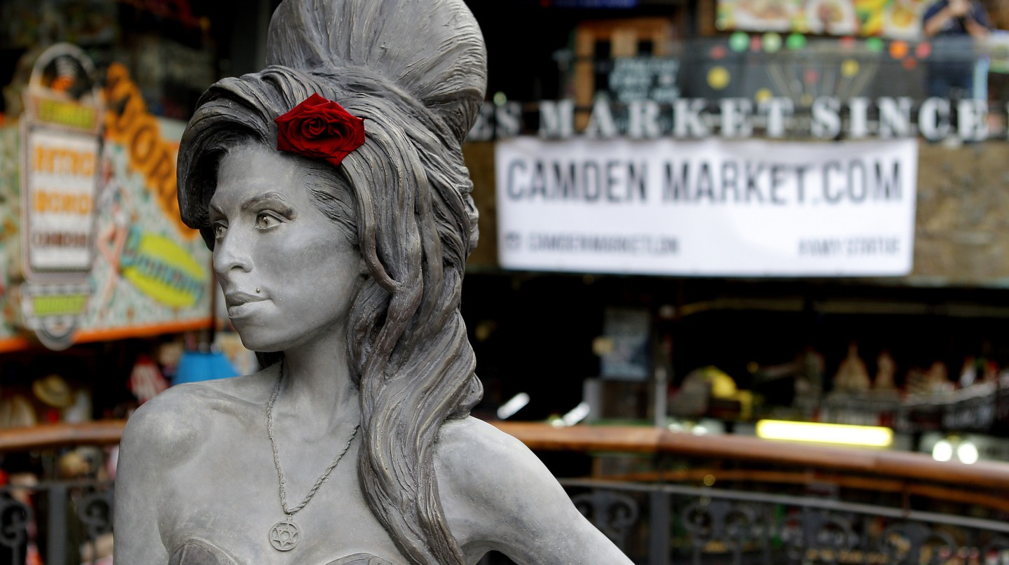 A life-size bronze statue of Camden local Amy Winehouse, complete with a red rose in her trademark beehive hairdo