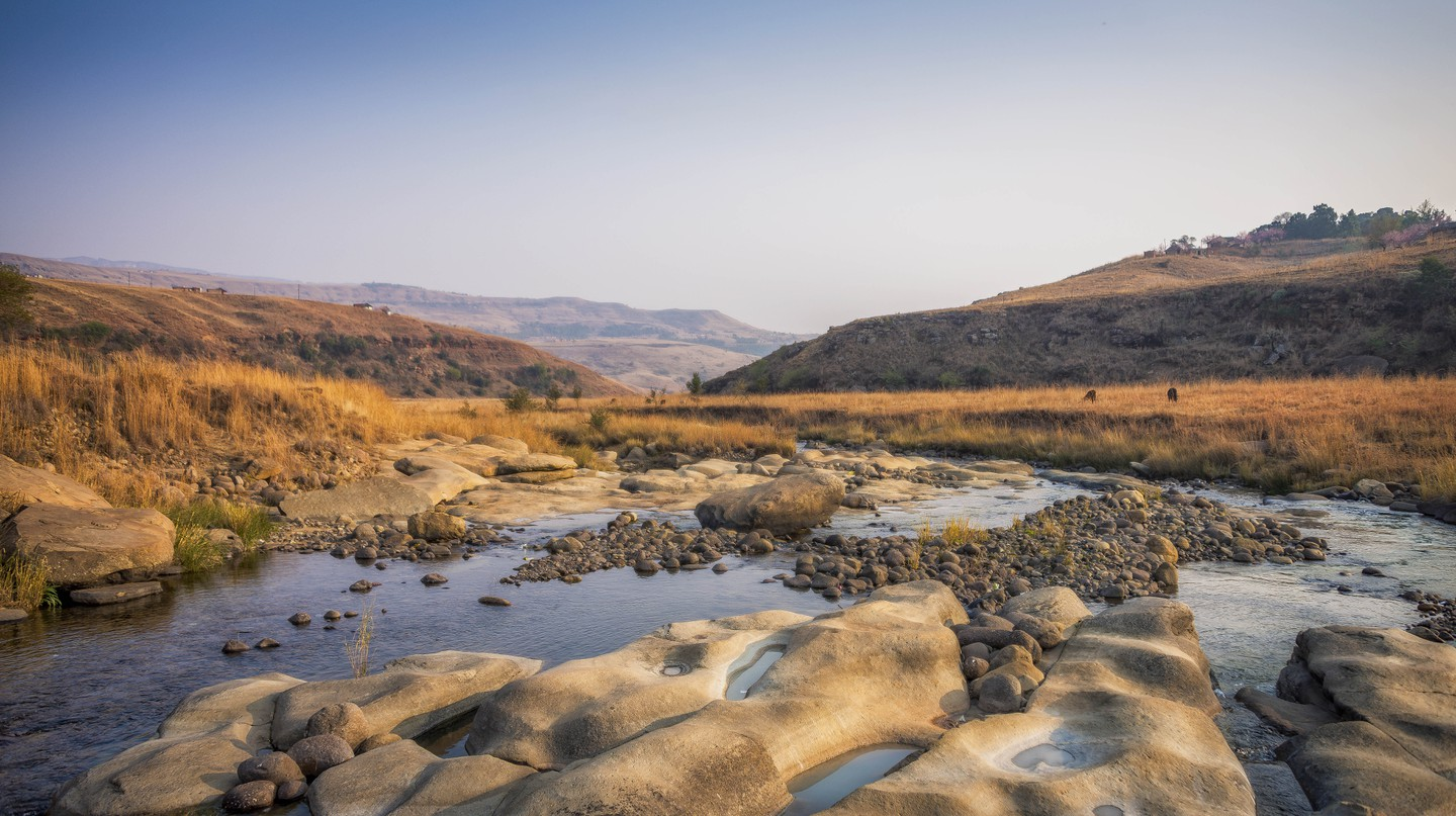 There is much to see outside Durban, like the Mhlwazini river in the Drakensberg mountains