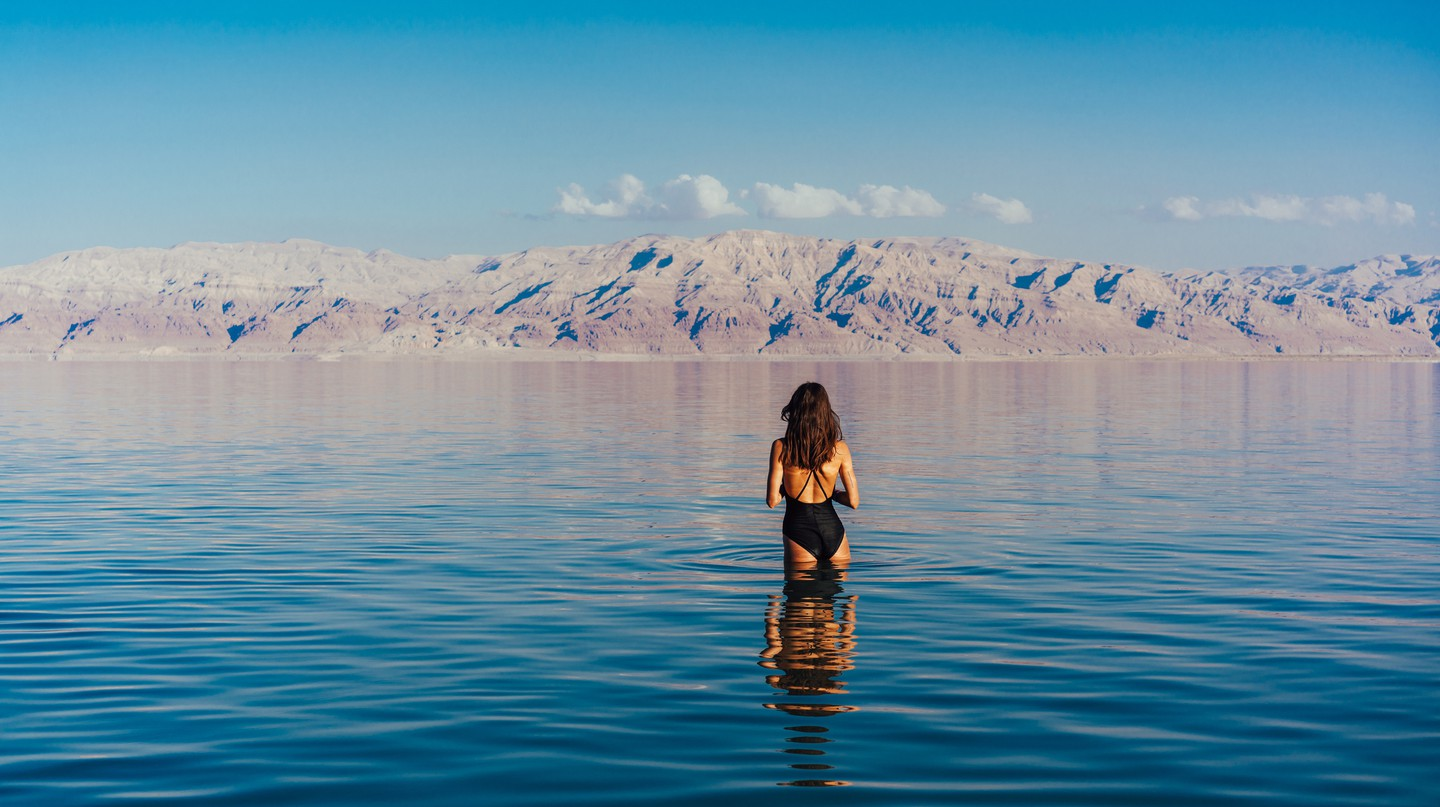 Floating on the surface of the Dead Sea's hyper-salty water is about as surreal and relaxing as it gets