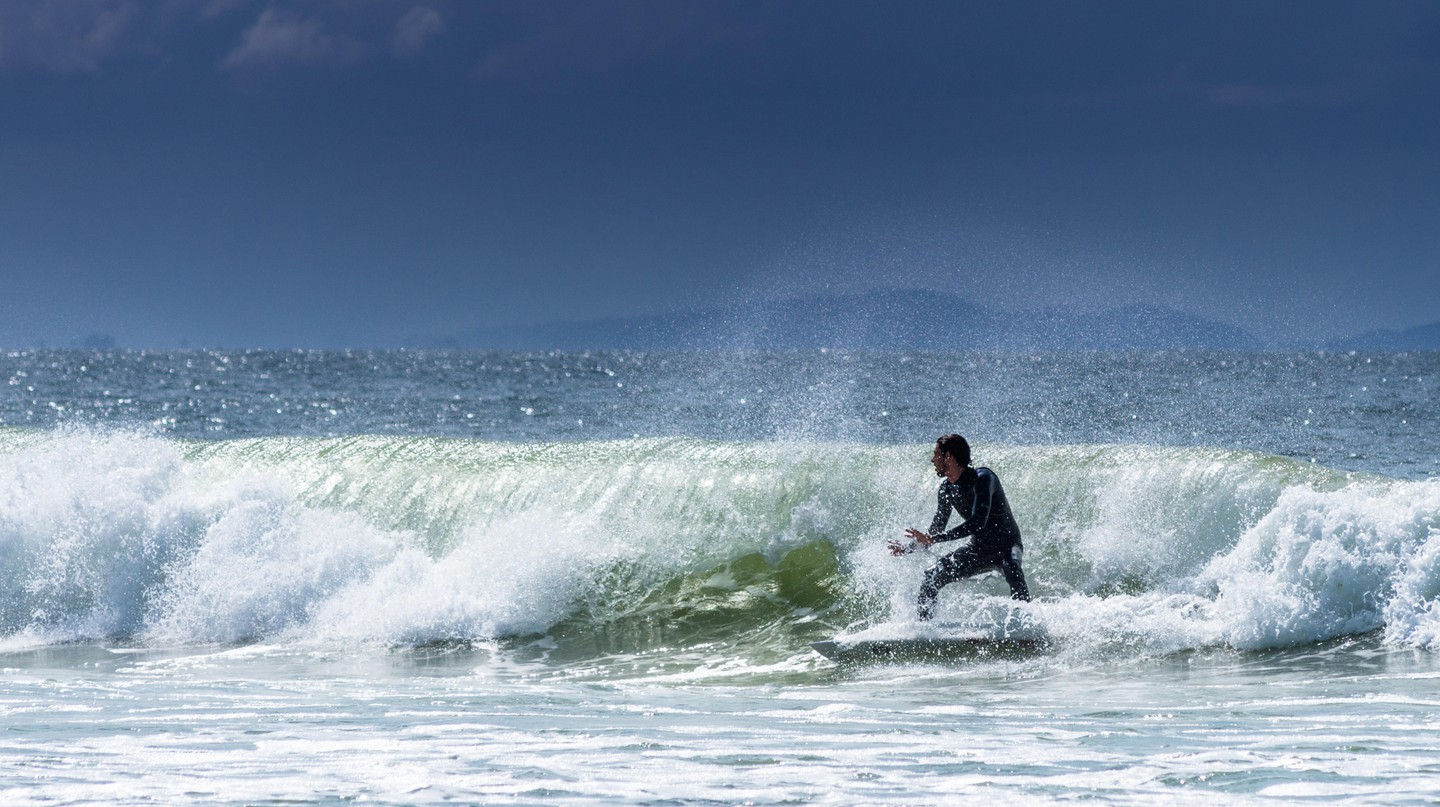 Surfing at The wreck off Belongil beach, Byron bay, New South Wales, Australia.
