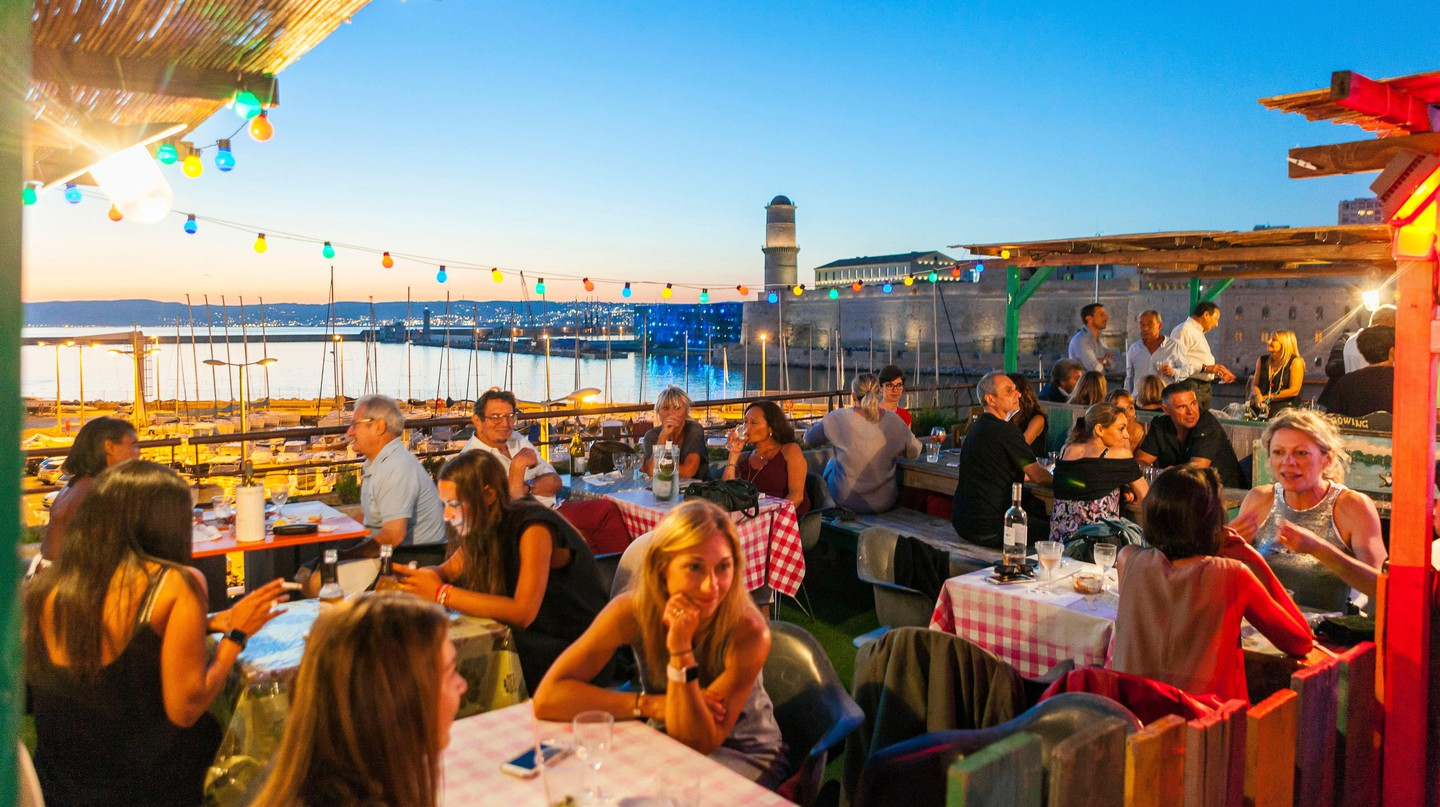 Spend the evening on the rooftop of the Rowing Club, overlooking Marseille's Fort Saint-Jean