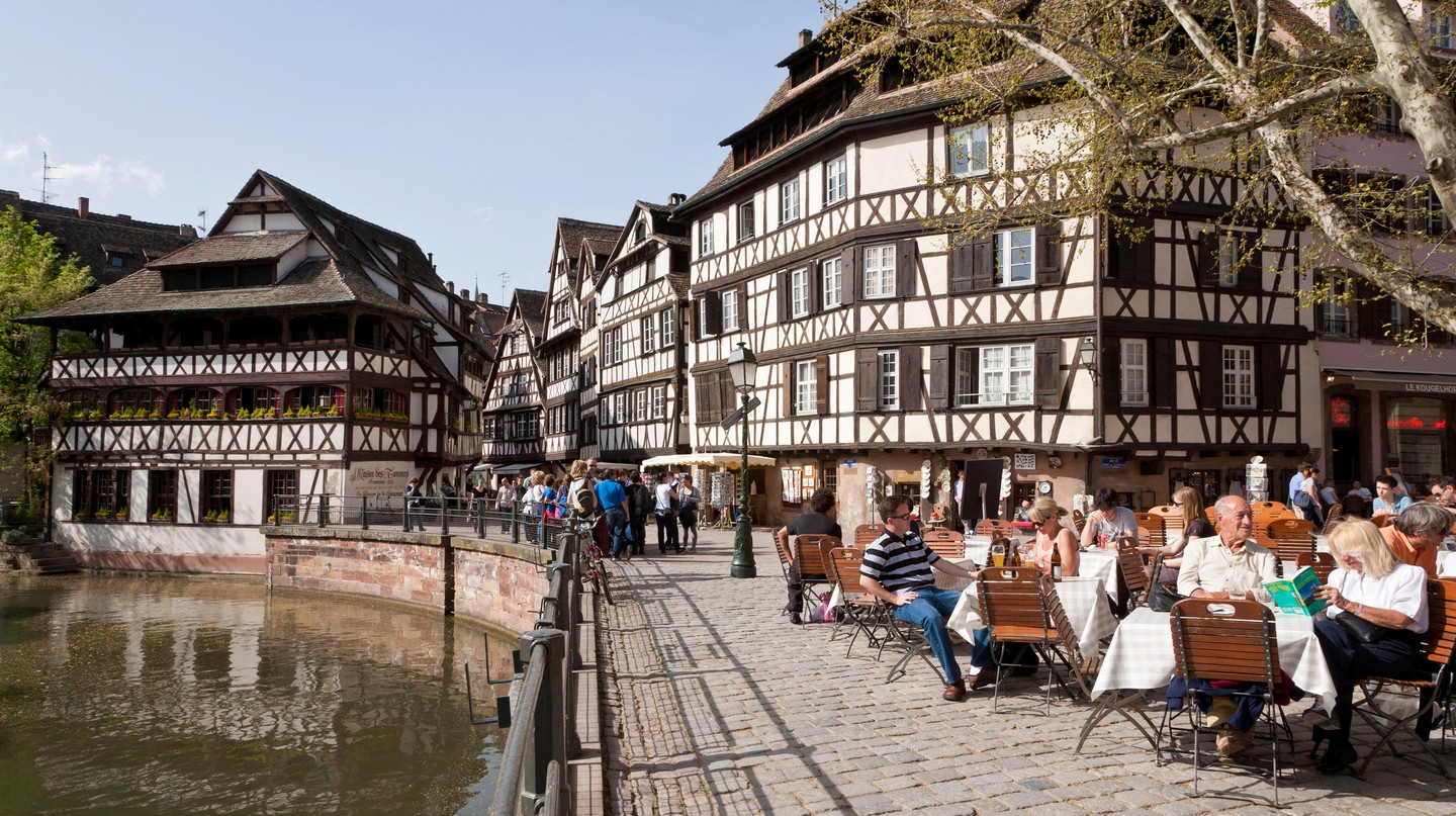 Cafe, restaurant on Place Benjamin Zix square, half-timbered houses, L'Ill river, Petite France, Strasbourg, Alsace, France