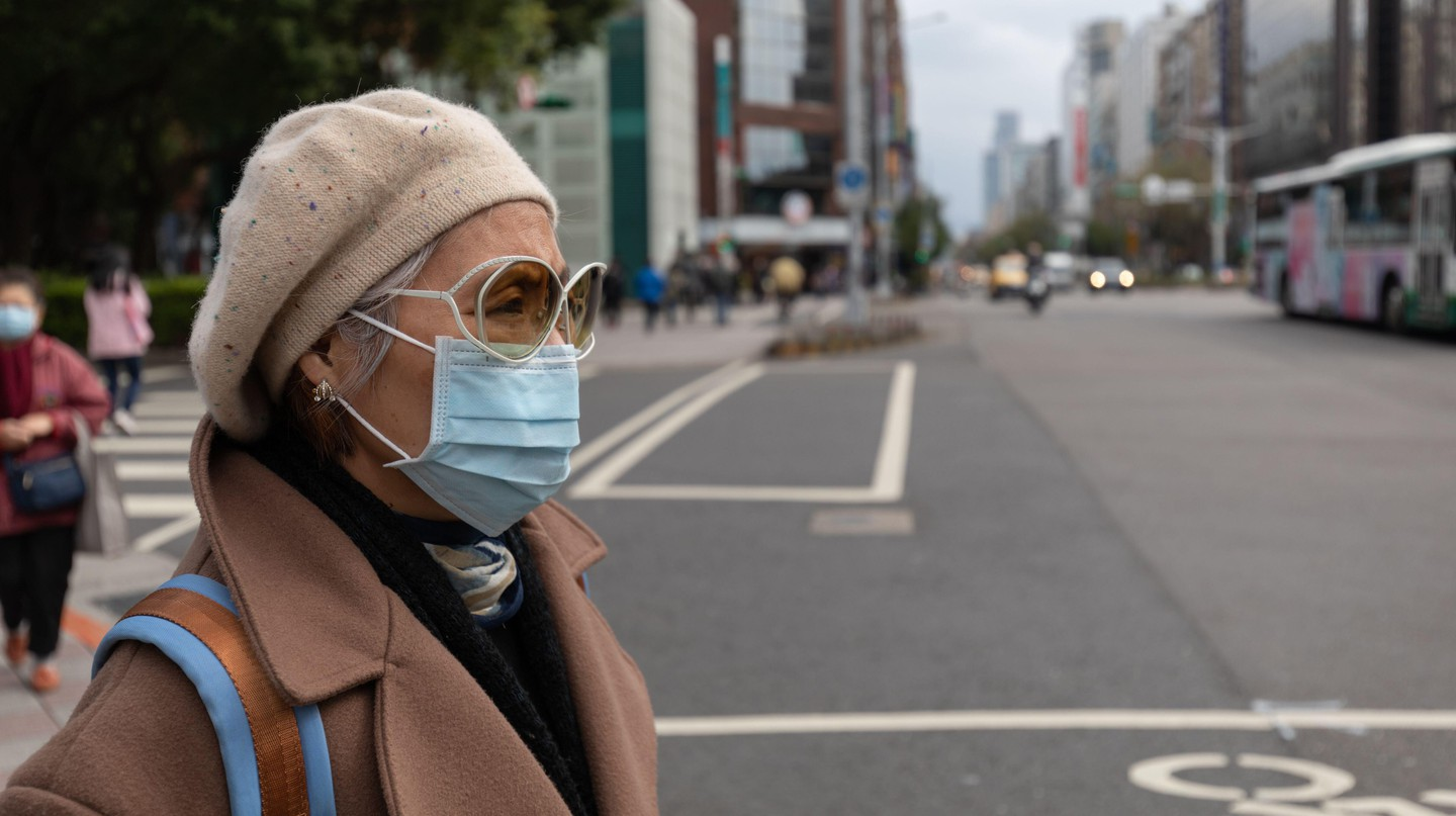 A woman wears a face mask to protect herself from the spread of coronavirus
