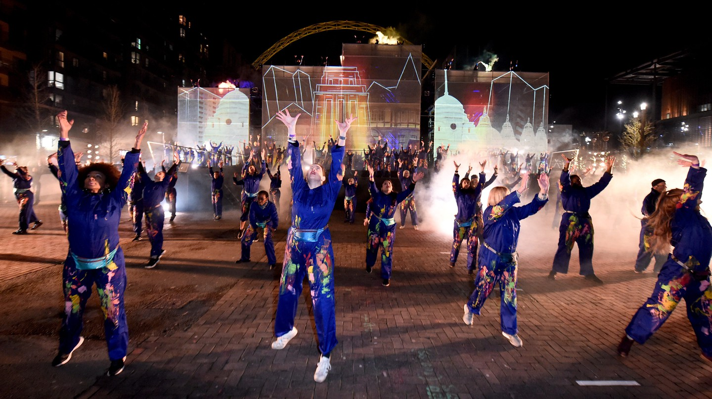 An outdoor performance to celebrate the launch of Brent's year as London Borough of Culture 2020 hosted by Wembley Park takes place along Olympic Way in front of Wembley Stadium