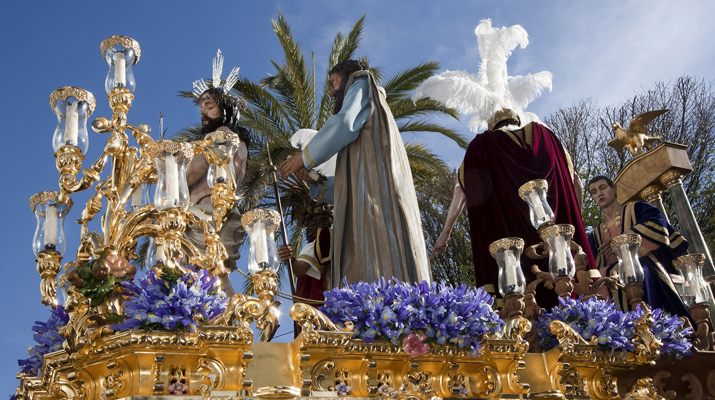 An ornate parade float forms part of the procession during Holy Week in Carmona in Andalucía, Spain