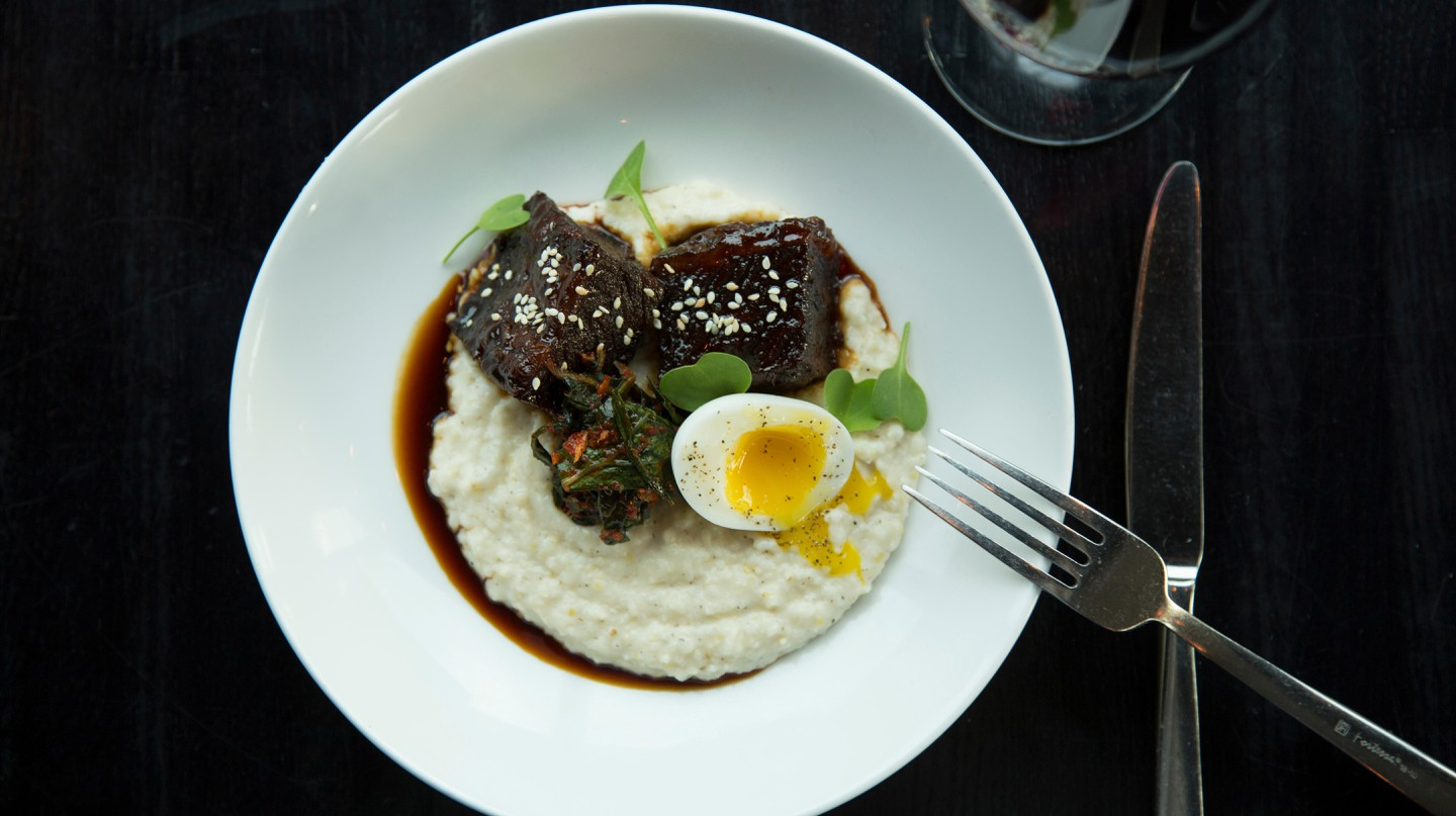 Short rib served with grits, collard-green kimchi and a soft-boiled egg
