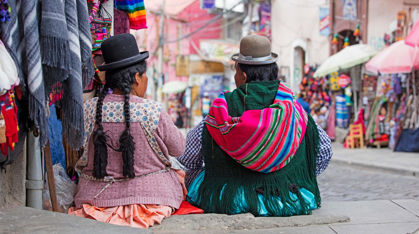 Cholita women from Bolivia's indigenous Aymara tribe. The tradition of wearing bowler hats is thought to have started a century ago, when a shipment of the hats, sent to British railway workers who were stationed in the country, turned out to be too small |