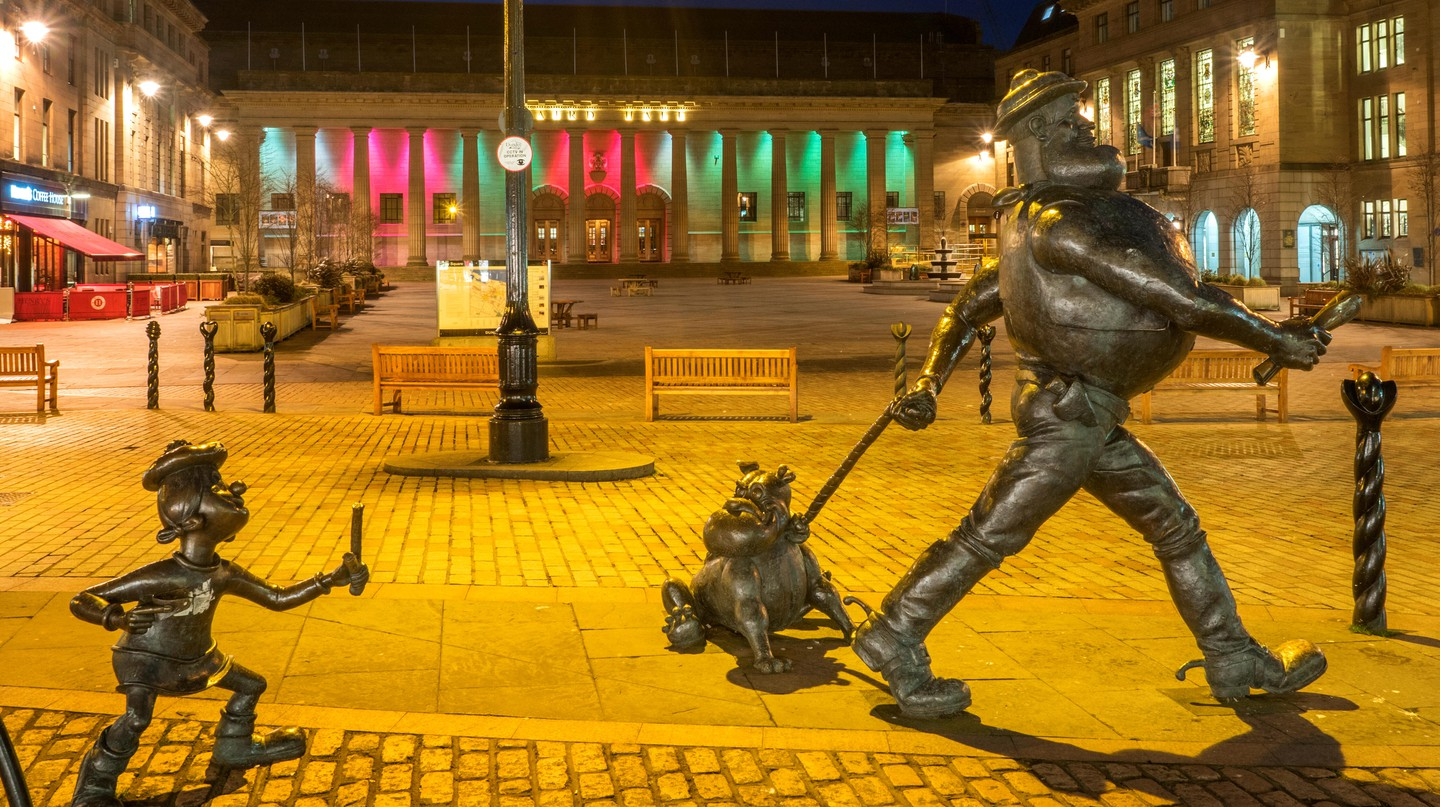 Statues of Minnie the Minx with Desperate Dan and Dawg grace the high street in Dundee