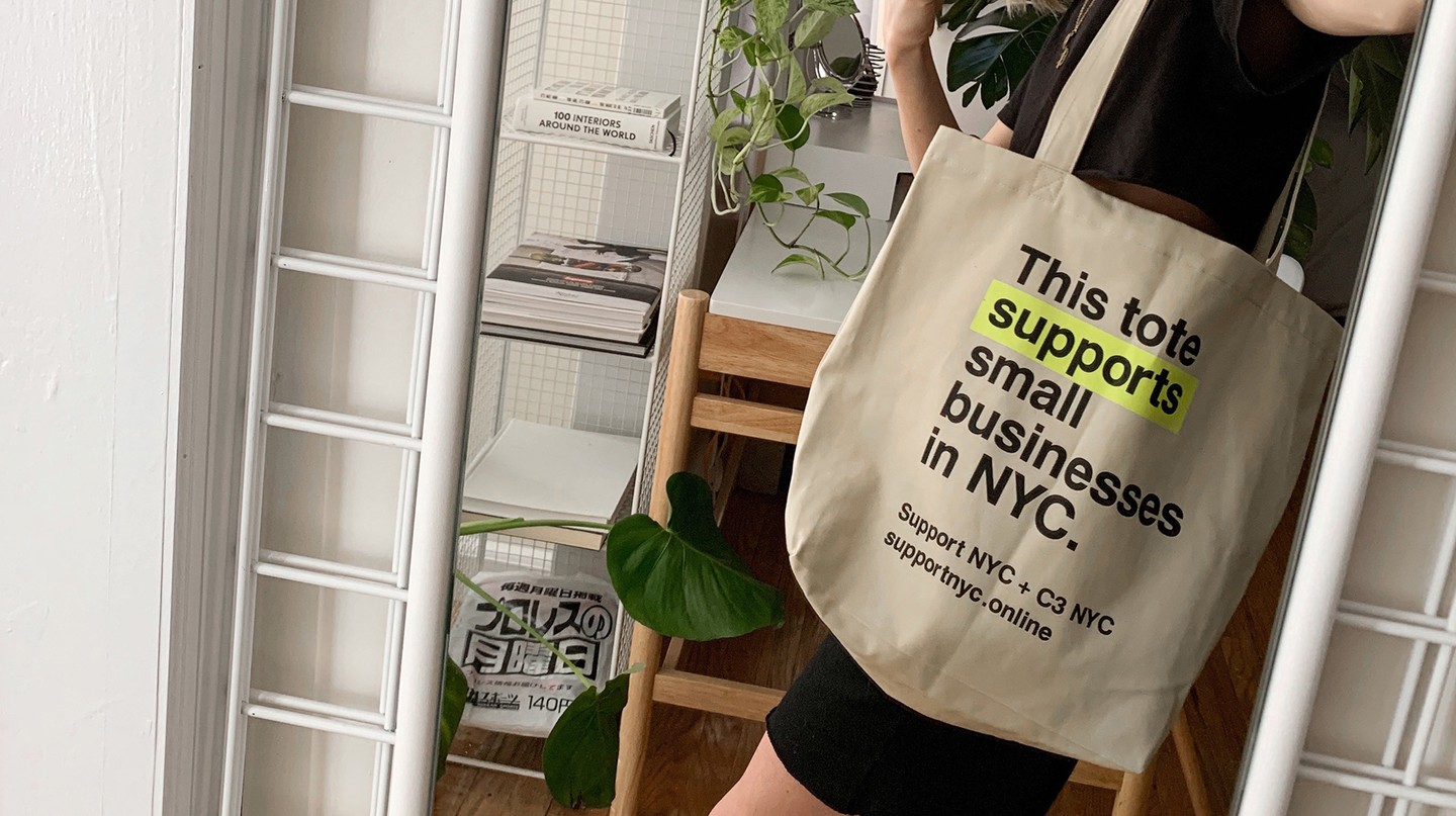 The SupportNYC custom tote bag conveys the project's message