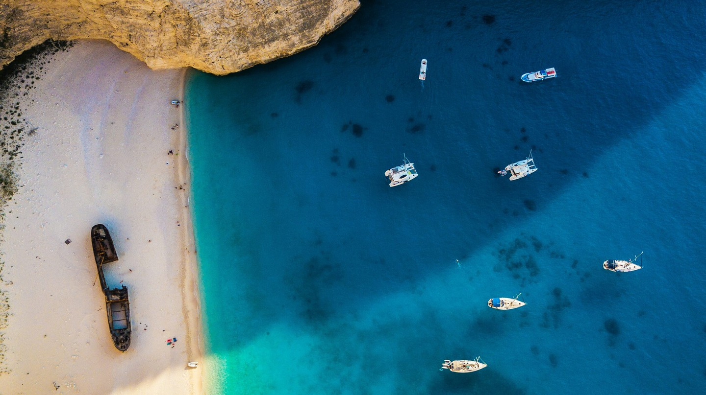 The idyllic blue waters and white sands of Navagio Beach