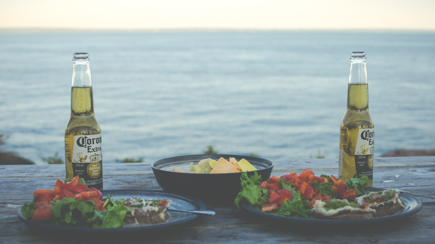 Enjoy beers while camping on the banks of the Saint Lawrence in Tadoussac, Quebec