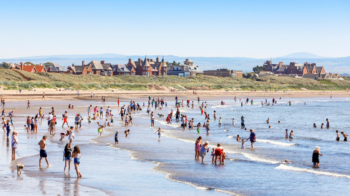 Many take advantage of the unusually hot weather and take to the beach to cool off, sunbathe or take a swim in the sea