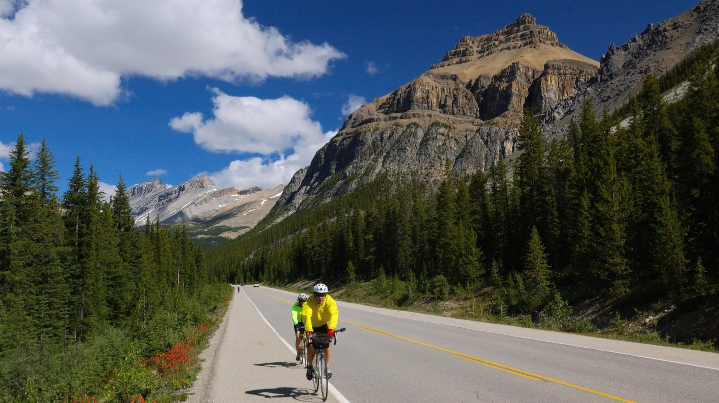 Bicyclists on the Icefields Parkway Banff National Park, Canada, Alberta