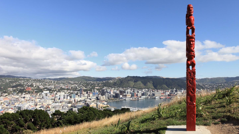 A Māori sculpture sits atop Mount Victoria in Wellington
