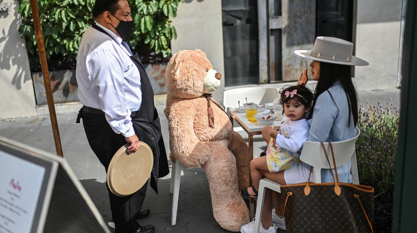 A teddy bear sits at a customer's table in a restaurant in the Polanco neighborhood of Mexico City to encourage social distancing