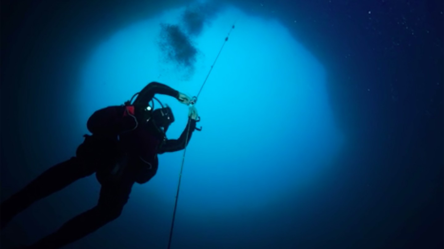 Scientists collect various samples from blue holes to learn more