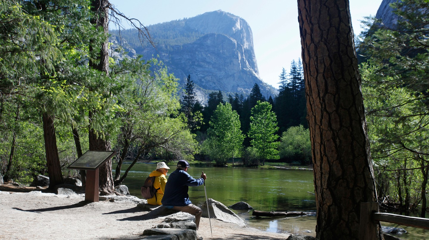 Hikers rest on the shore of Mirror Lake, Yosemite National Park