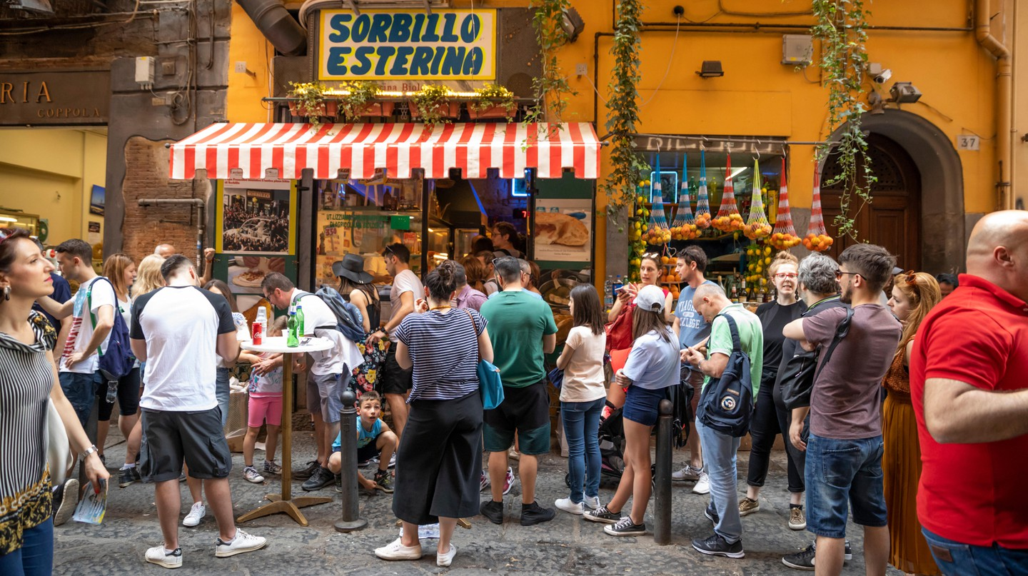 A queue of hungry visitors waiting for a famous Sorbillo take-away pizza