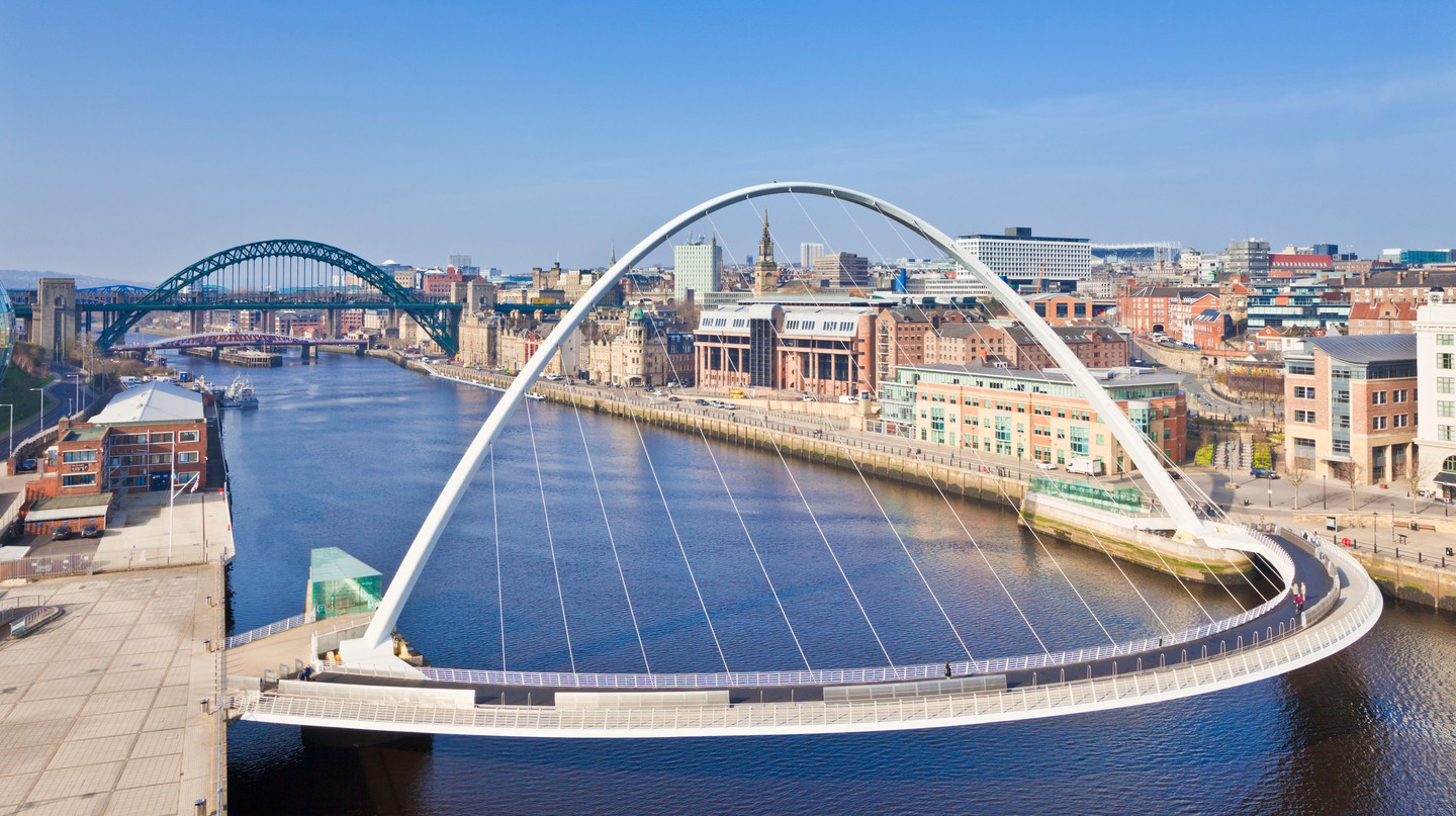 Millennium Bridge soars over the Quayside area of Newcastle, known for its nightlife
