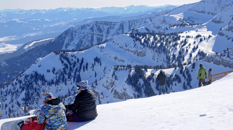 Snowboarders enjoying the mountain views of Jackson Hole