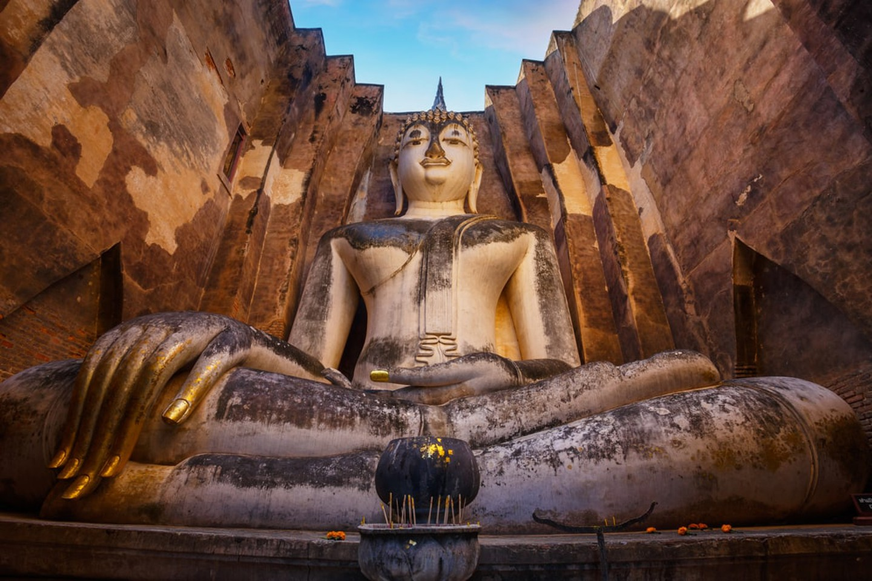 Seated Buddha at Wat Si Chum temple in Sukhothai Historical Park, Thailand