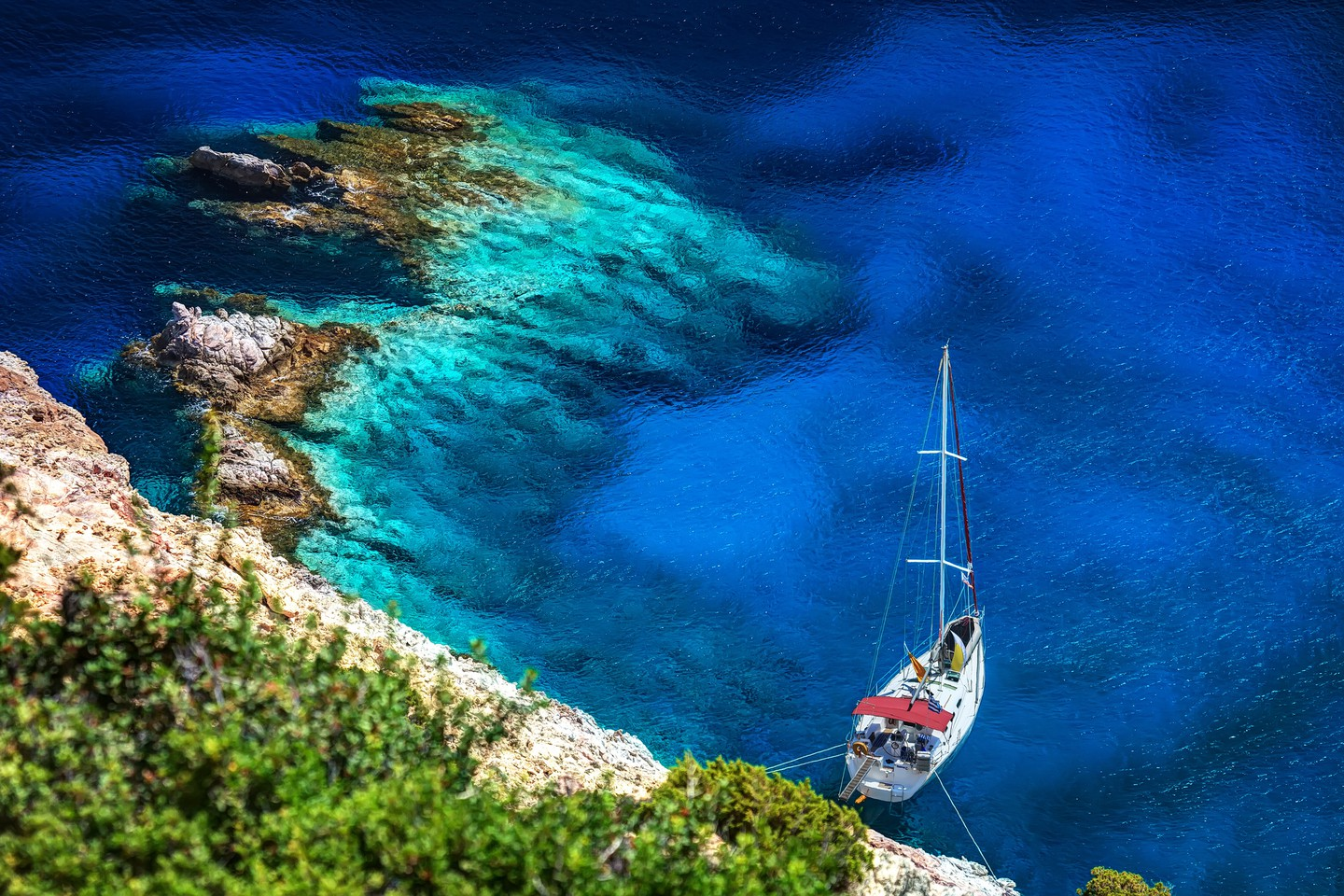 Dive off a yacht moored in a secluded cove