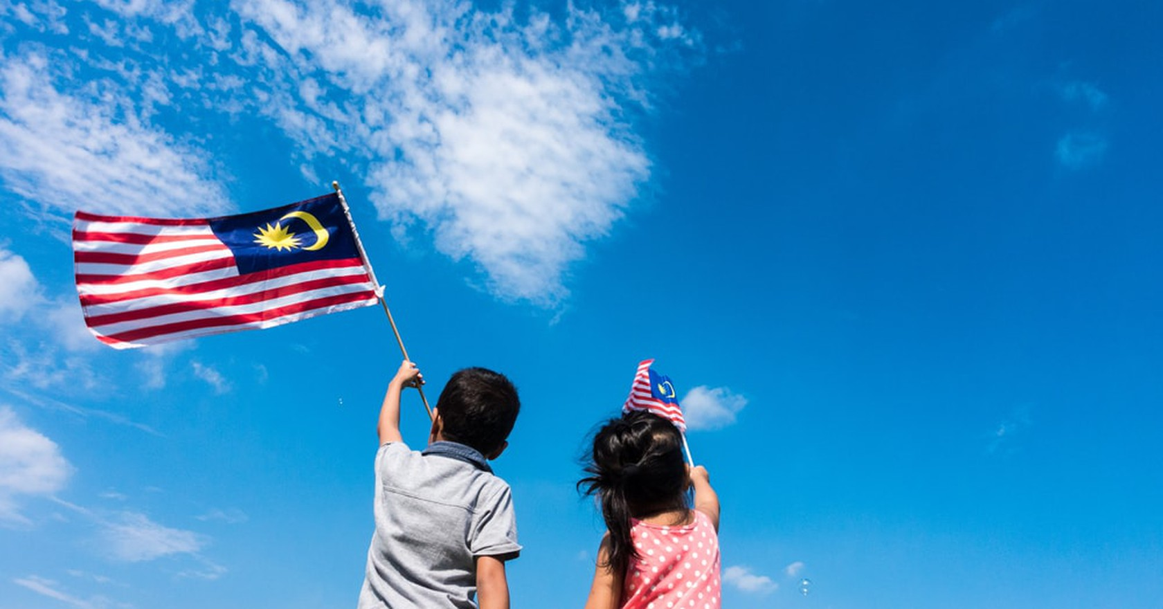 Kids Wave A Malaysian Flag On Independence Day