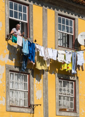 Hanging washing on the Cais da Ribeira, Porto, Portugal.