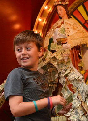 BOSTON, MA - AUGUST 23:  Benjamin Gatto smiles to his family as he pins money onto Santa Lucia before the opening procession for the Feast of St. Anthony in the North End August 23, 2019 in BOSTON, Massachusetts. (Staff Photo By Chris Christo/MediaNews Gr